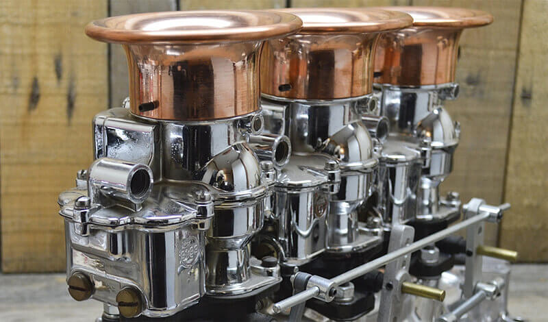 Copper rolled edge velocity stacks by So-Cal Speed Shop